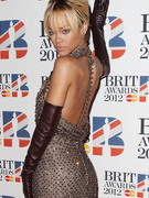 Rihanna Hits Red Carpet After Controversial Chris Brown Duet