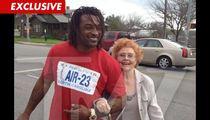 NFL Star Cedric Benson Helps an Old Lady Cross the Street