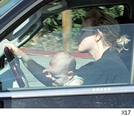 Britney Spears driving with Sean Preston in her lap.