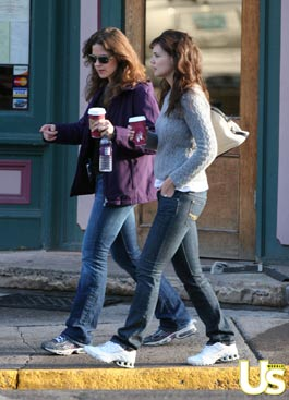 Katie Holmes walks with friend