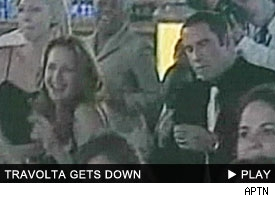 John Travolta: Click to watch