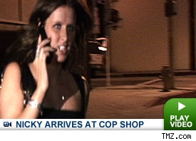 Nicky Hilton arrives at police station: Click to watch