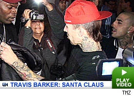 Travis Barker plays Santa.