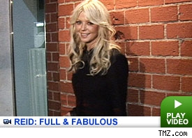 Tara Reid: Click to watch
