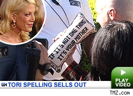 Tori Spelling Sells Out: Click to Watch