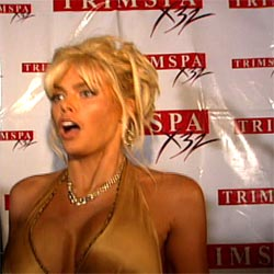 Anna Nicole Smith in front of Trim Spa billboard