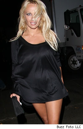 Pam Anderson in short black skirt