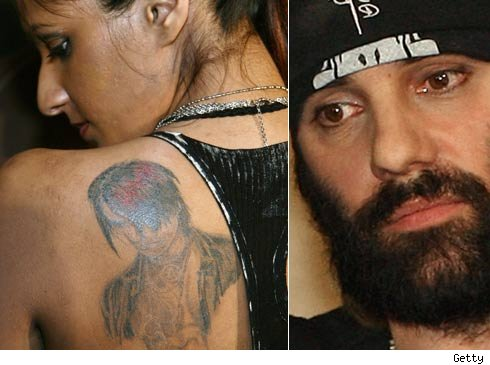 image of himself inked onto a delusional fan's unfortunate back tattoo.