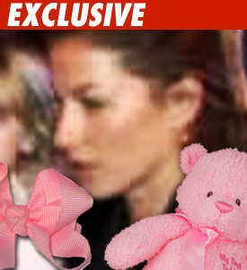 Gisele Bundchen-- Baby Girl on Board?