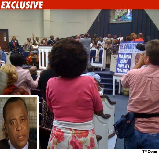 http://ll-media.tmz.com/2010/06/14/0614-conrad-murray-ex-02-credit.jpg