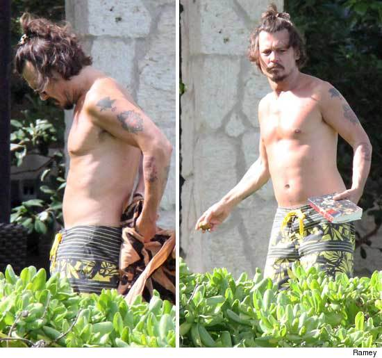 Rockin' a samurai 'do and no shirt, Johnny Depp enjoyed his day in the sun