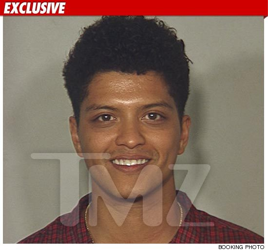 Singer Bruno Mars has more in common with Paris Hilton than a smiley mug