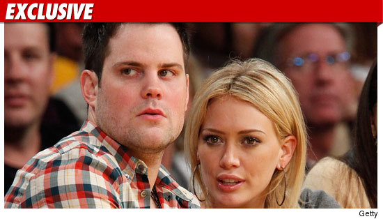 1001_mike_comrie_hilary_duff_EX_getty