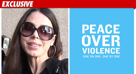 1115_oksana_peace_over_violence_EX_tmz