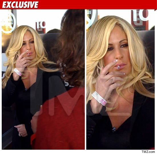 1126_Kim_Zolciak_smoking_WM_EX