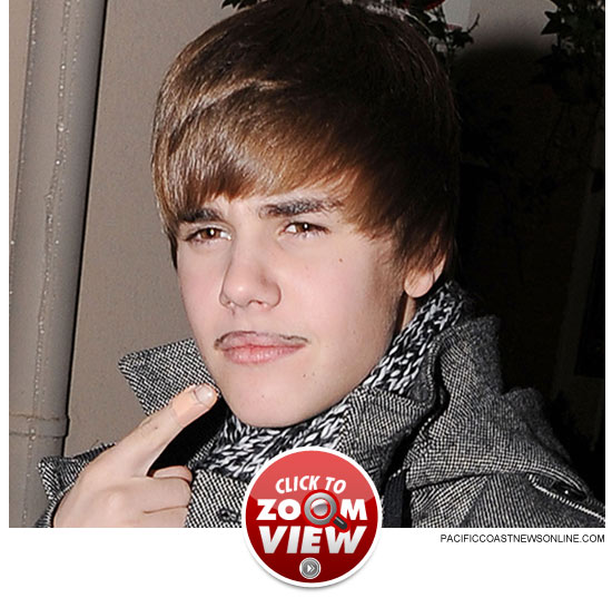 http://www.tmz.com/2010/12/03/justin-biber-fake-mustache-drawn-ink-teen-pop/