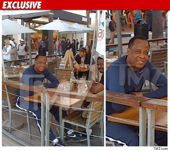 0120_conrad_murray_TMZ_WM_EX