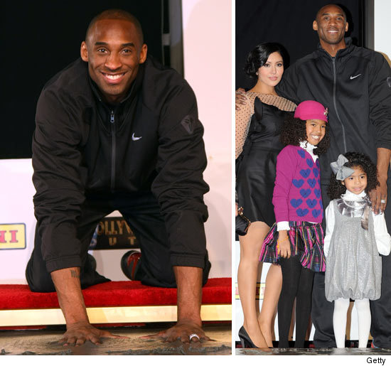 With his wedding ring on full display Kobe Bryant with his wife Vanessa