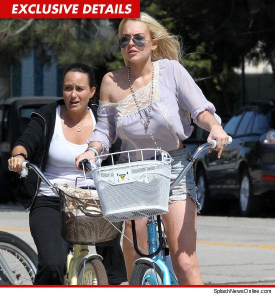 0728_lindsay_lohan_bike_splash_exd