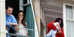 Mila Kunis Dangles From MJ's Hotel Balcony