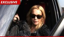 Lindsay Lohan -- Good Sam Returns Cell Phone with 'Photos'