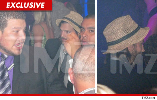 Ashton Kutcher partying solo