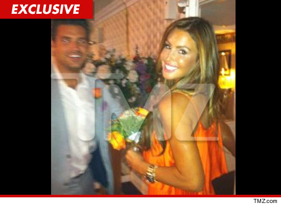 Rachel Uchitel orange dress