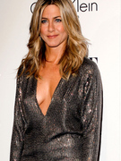 Jennifer Aniston Shows Off Cleavage At Star-Studded Elle Event