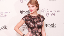 Taylor Swift May Sue Over Topless Photo
