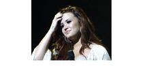 Demi Lovato Breaks Down During Show