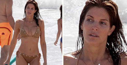 Stephanie Seymour -- Spills Out Onto the Beach