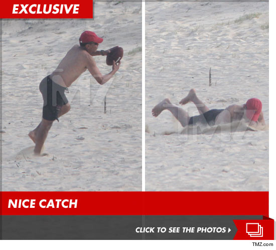 Barack Obama shirtless playing beach football