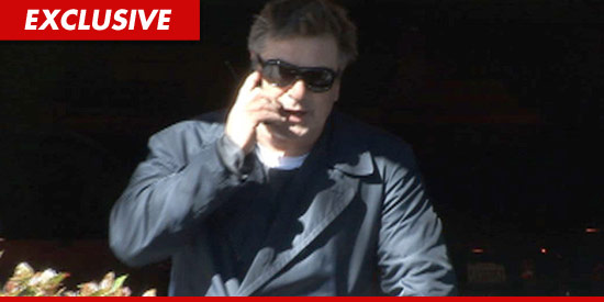 Alec Baldwin on the phone