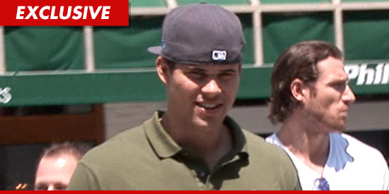 Kris Humphries with a baseball hat