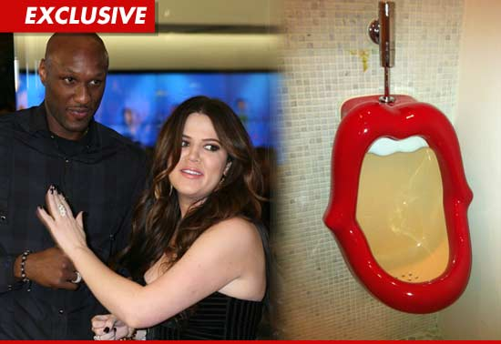 Lamar Odom and Khloe Kardashian kiss urinal