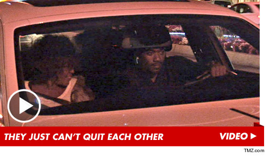 Whitney Houston and Ray J in a car together
