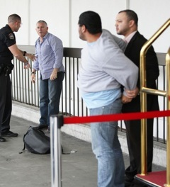 Justin Bieber's security fights photographer