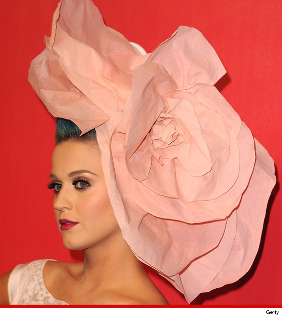 Katy Perry at the 2012 MusiCares with a strange pink hat
