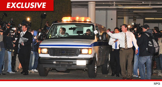 The body of Whitney Houston being removed from the Beverly Hills Hilton in an ambulance.
