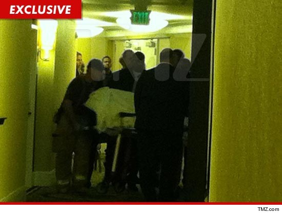 The body of Whitney Houston was just removed from the room on a gurney.  It will go to the morgue for an autopsy to determine cause of death.