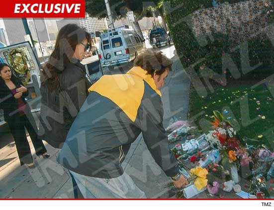 Paul McCartney and his wife Nancy Shevell lay flowers at a makeshift memorial for Whitney Houston