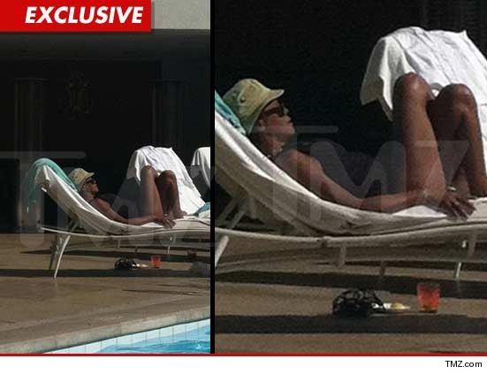Whitney Houston was photographed relaxing poolside at the Beverly Hilton.