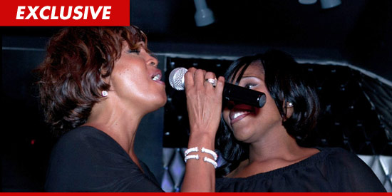 0214_whitney_singing_EX-023