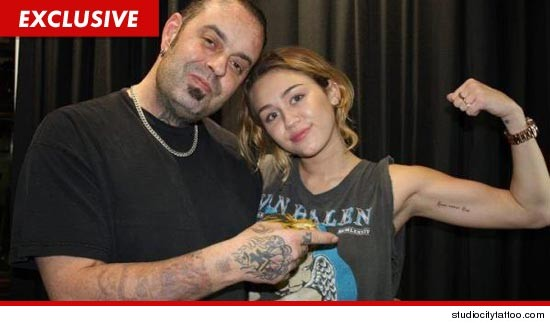 Miley Cyrus tattooed Love Never Dies on the inside of her left bicep.