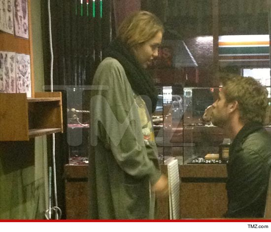 Miley Cyrus and boyfriend Liam Hemsworth at Studio City Tattoo.