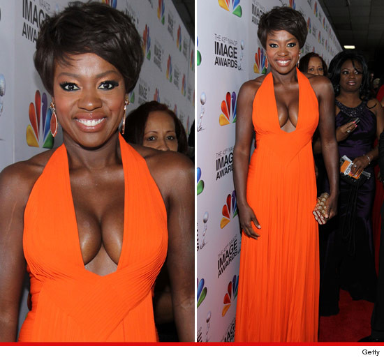 Viola Davis in a plunging low cut orange dress showed off some MAJOR cleavage.