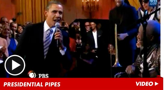 0222_brack_obama_presidential_pipes