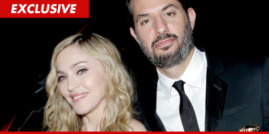 0227_madonna_guy_oseary_ex