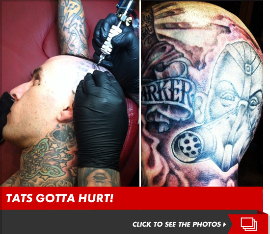 Travis Barker tattoos the Transplants logo on his head