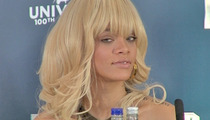 Rihanna Slams Reporter for Asking About Ashton Kutcher
